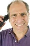 Expert en logiciel heureux de propriétaire de conversation téléphonique d'homme Image stock