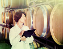 Expert examines equipment at winery Royalty Free Stock Photography
