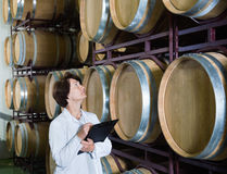 Expert examines equipment at winery Royalty Free Stock Photo