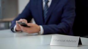 Expert financial advisor using mobile app on smartphone, planning investment stock photo