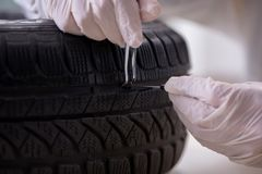 The expert is looking at car accident evidence. Expert is looking at car accident evidence royalty free stock images