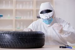 The expert is looking at car accident evidence. Expert is looking at car accident evidence royalty free stock image