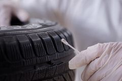 The expert is looking at car accident evidence. Expert is looking at car accident evidence royalty free stock photography