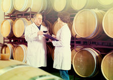 Expert and maker estimate wine Royalty Free Stock Photo