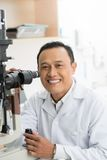 Expert in optics Royalty Free Stock Images
