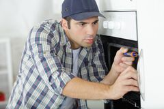 Expert panel fixing kitchen oven. Expert panel fixing the kitchen oven stock photos