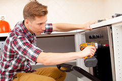 Expert panel fixing the kitchen oven Stock Photo
