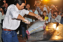 An expert is performing tuna fillet techniques at Vietnam seafood festival in Tuy Hoa city Royalty Free Stock Photos