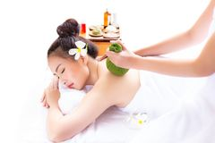 Expert or professional of massage of aromatherapy use herbal ball for massaging a beautiful customer's back with warm herbal ba stock photos