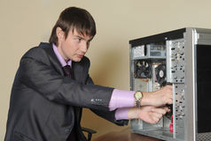Expert repairing the computer Royalty Free Stock Photos