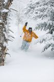Expert skier skiing powder snow in Stowe, Vermont,. Expert skier skiing in deep powder snow in front of a frozen waterfall, Mt. Mansfield, Stowe, Vermont, USA Royalty Free Stock Photo