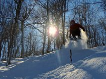 An expert skier with sun skiing in Vermont USA stock photography