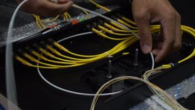 Expert technicians are connecting fiber optic cables