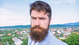 Expert tips for growing and maintaining mustache. Hipster serious handsome attractive guy with long beard. Man bearded. Hipster with mustache blue sky stock photography