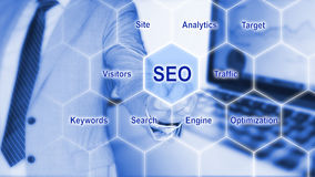 IT expert touches grid with seo keywords Royalty Free Stock Photography
