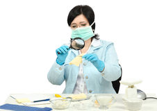Expert viewing closely a cheese slice in laboratory Stock Images