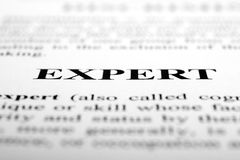 Expert. The word Expert shot with artistic selective focus royalty free stock photo