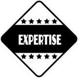 EXPERTISE on black diamond shaped sticker label. Stock Photography