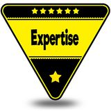 EXPERTISE on black and yellow triangle with shadow. Royalty Free Stock Photos