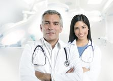 Expertise doctor beautiful nurse hospital Stock Image