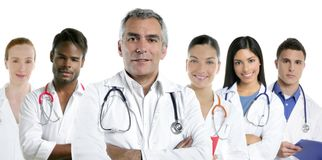 Expertise doctor multiracial nurse team row. Expertise gray hair doctor multiracial nurse team row over white royalty free stock photo