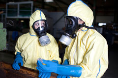 Experts analyzing infested material. Possible accident with chemicals pollution royalty free stock photos