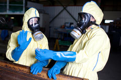 Experts analyzing infested material. Possible accident with chemicals pollution stock photography