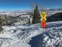 Experts Only, Thin Cover. `Experts Only`, `Thin Cover` warning signs at the top of a ski run on Deer Valley mountain royalty free stock images