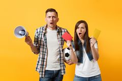 Expessive fun crazy couple, woman man football fans screaming, upset of loss, goal of favorite team with soccer ball. Expessive crazy couple, woman man football stock photography