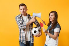 Expessive fun crazy couple, woman man football fans screaming, upset of loss, goal of favorite team with soccer ball. Expessive crazy couple, woman man football royalty free stock images