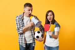 Expessive fun crazy couple, woman man football fans screaming, upset of loss, goal of favorite team with soccer ball. Expessive crazy couple, woman man football royalty free stock photos