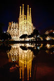 Expiatory church of La Sagrada Familia in Barcelon. Night shot with reflections in a pond of atoning Temple of Sagrada Familia in Barcelona Stock Images
