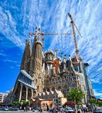 The Expiatory Temple of the Holy Family. BARCELONA, SPAIN - MAY 13, 2017: View of the Expiatory Temple of the Holy Family Sagrada Familia with a beautiful blue Royalty Free Stock Photos