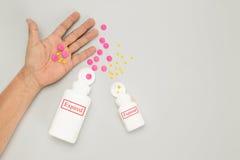 Expired drug on elderly hand Royalty Free Stock Image