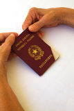 An expired passport in the hands of an old woman Stock Image