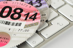 Expired UK vehicle tax disc on a keyboard. Stock Images