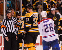 Explain a call. Referrees explain fighting penalties to Boston Bruins captain Zdeno Chara Royalty Free Stock Photography
