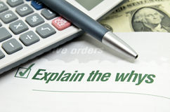 Explain the whys. Printed on book with calculator and pen stock photography