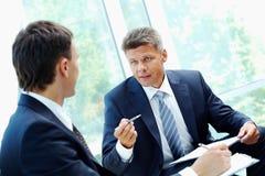 Explaining. Image of smart boss explaining to colleague business idea Royalty Free Stock Photography