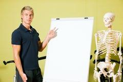 Explaining basic anatomy in gym Stock Image