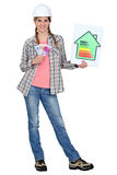 Explaining benefits of energy efficiency. Woman explaining benefits of energy efficiency stock photos
