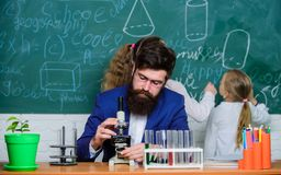 Explaining biology to children. Biology plays role in understanding of complex forms of life. School teacher of biology. Man bearded teacher work with royalty free stock images