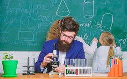 Explaining biology to children. Biology plays role in understanding of complex forms of life. School teacher of biology. Man bearded teacher work with stock images