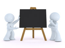 Explaining on a black board Royalty Free Stock Photography