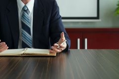 Explaining. Cropped image of businessman explaining strategy and gesturing with his hands Royalty Free Stock Image