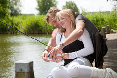 Explaining the fishing rod Stock Image