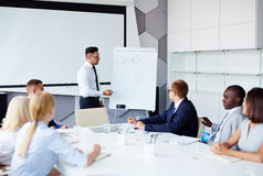 Explaining graph and diagram Royalty Free Stock Photo