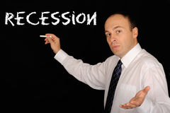 Explaining Recession. Businessman related to finance industry teaching about 'Recession stock images
