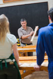 Explaining teacher and the woodwork class Stock Photos
