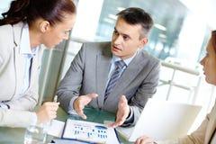 Explaining work Royalty Free Stock Photo